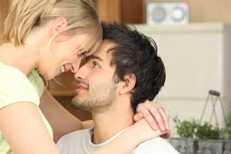 tenderly: Young woman staring at her boyfriend tenderly