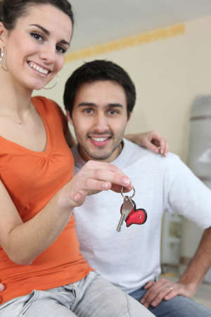 settling: happy couple settling together Stock Photo