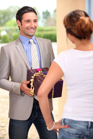 Man giving gift to woman photo