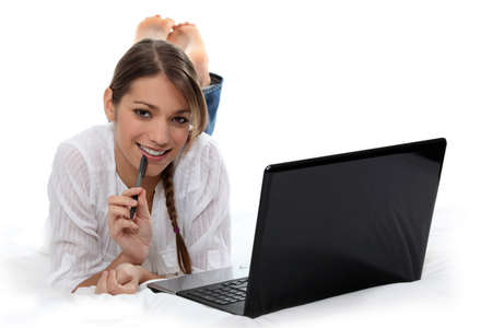 undergrad: Woman working on her laptop Stock Photo