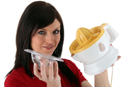 Woman holding juicer photo