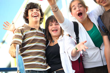 school bags: teenagers celebrating the end of the year