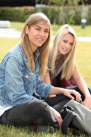 Two teenage girls sitting in a park Stock Photo - 12376134