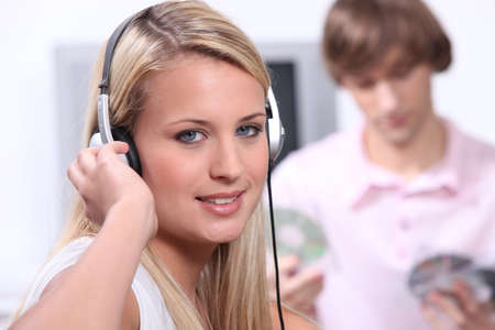 Teenagers listening to music on headphones photo