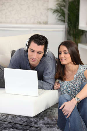 Young couple relaxing at home photo