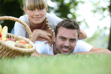 healthy living: Young couple having a picnic in the park