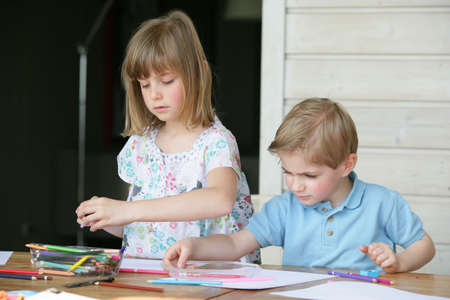 Brother and sister coloring in photo