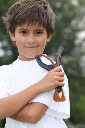 Little boy holding catapult Stock Photo - 12366048