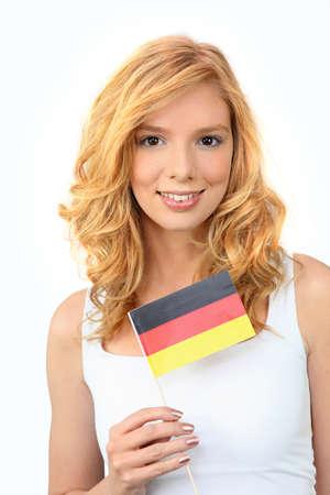 Pretty woman waving a German flag photo