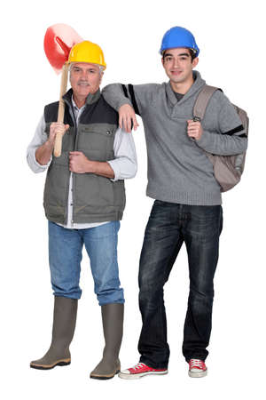 Builder with young apprentice photo