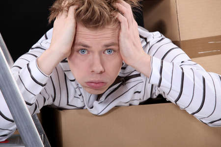 swamped: Overwhelmed man on moving day Stock Photo