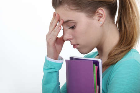 annoying: Stressed female teenager worried about exams Stock Photo
