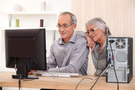 literacy: Elderly couple learning computer skills Stock Photo