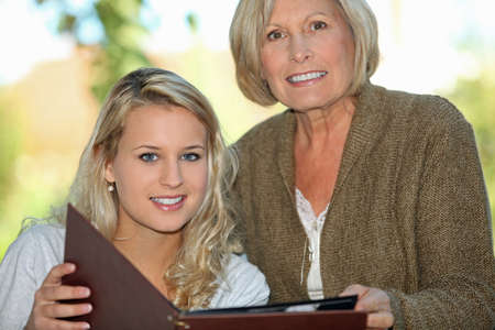 Senior and her granddaughter looking at photos Stock Photo - 12374240