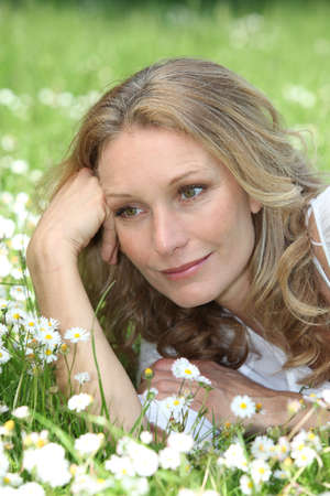 grown ups: Woman lying in the daisies