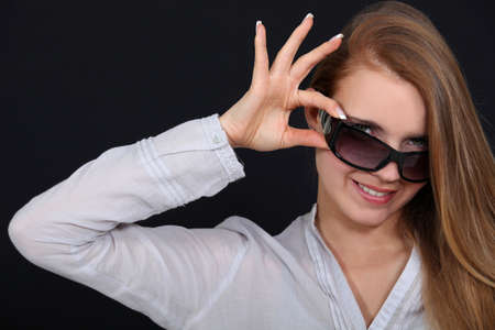 tipping: Woman tipping sunglasses