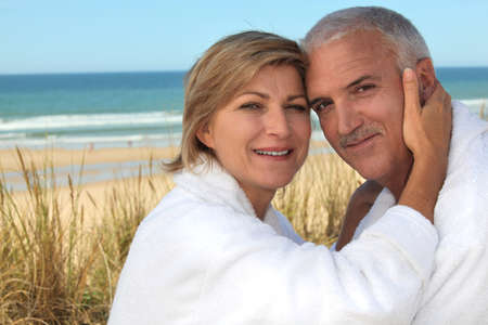 A cute middle age couple at the beach. photo