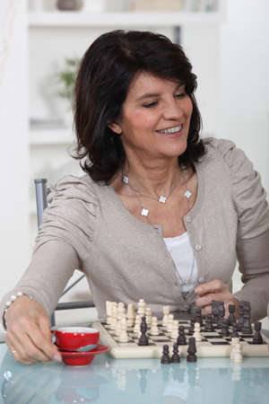 Woman playing chess photo