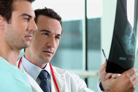 electromagnetic radiation: doctor and assistant with x-ray