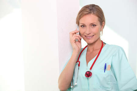 Nurse on the phone Stock Photo - 12366039