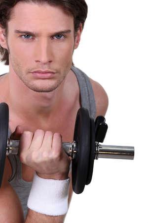 Man lifting dumbbell photo