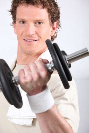 alpha: Man lifting dumbbell