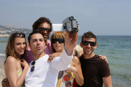 Friends on holiday with a video camera photo