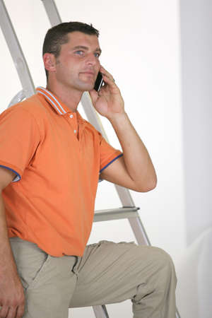 Man making call next to step-ladder photo