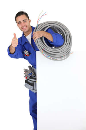 electric wires: Young electrician