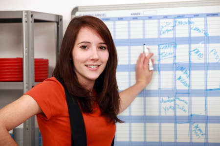 assistant engineer: factory worker filling the schedule Stock Photo