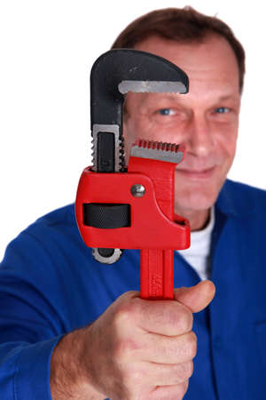 wage earner: Plumber holding large tool Stock Photo