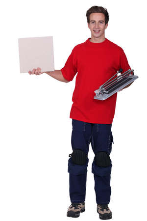 portrait of young delivery man holding board Stock Photo