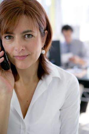 Secretary answering the telephone photo