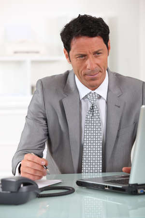 man 40 50: Male executive at laptop