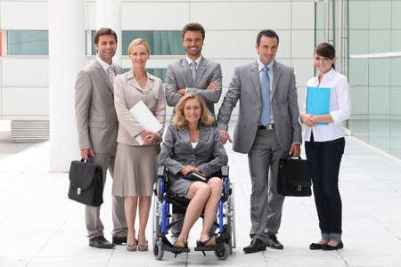 limitation: Business people stood outside building