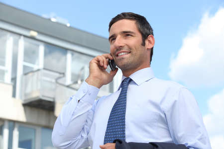 property for sale: Confident estate agent outside building Stock Photo