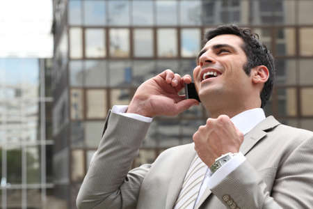 overjoyed: Businessman overjoyed with his phone call