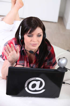 everywhere: young woman talking through a webcam
