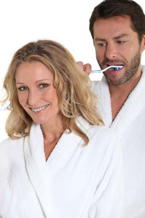 man front view: Couple brushing teeth Stock Photo
