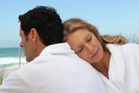 Couple by the sea in toweling robes photo