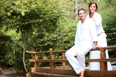 honey moon: a couple on a wooden bridge in a park