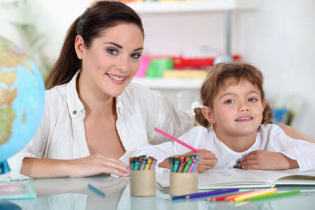 a female adult and a child girl drawing photo
