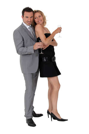 fro: couple stood together holding champagne glasses Stock Photo
