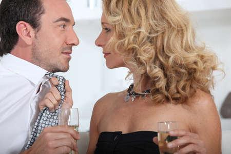 flirting: Woman pulling tie Stock Photo