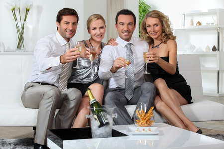 30 34 years: Two couples drinking champagne