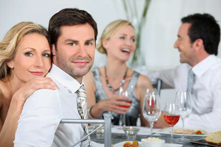 Couple at a dinner party photo