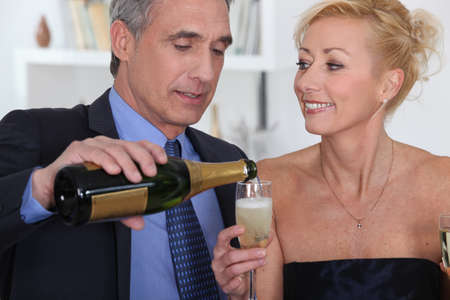Smart couple drinking champagne photo