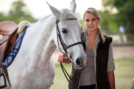 horse blonde: Horse riding Stock Photo