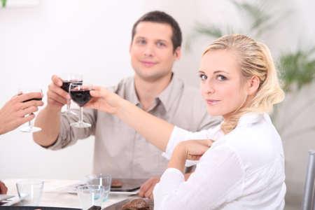 Friends making a toast at the dinner table Stock Photo - 12599764