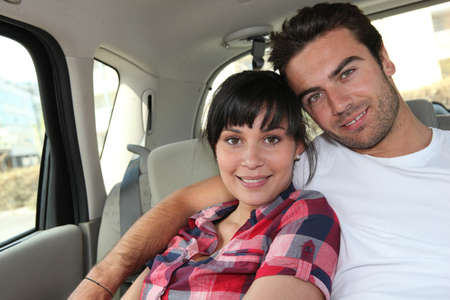 taxicab: Young couple in the back of a car